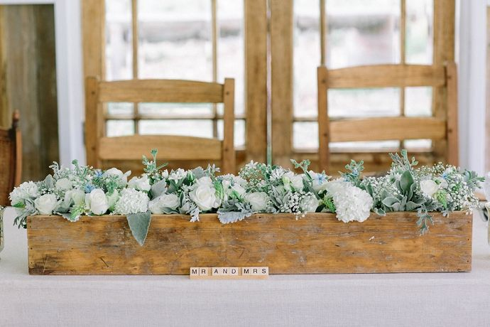 Head table in front of the gorgeous old doors.