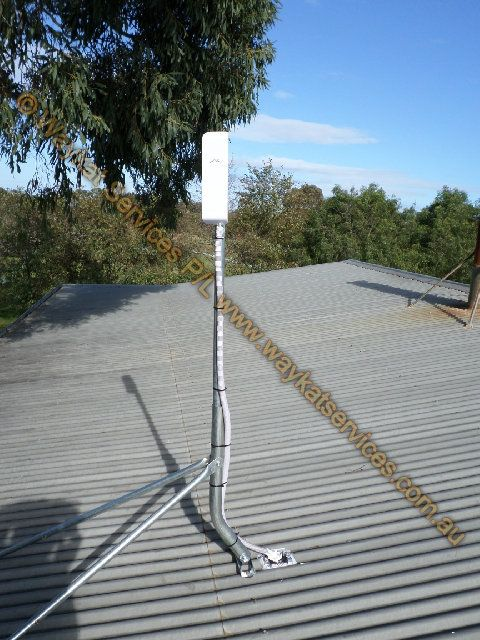 A close up view of the 1.5m mast with the Ubiquiti Nanostation M5 mounted atop carrying remote internet, Email and other data traffic between it and the main office