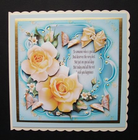 """I printed this gorgeous design onto glossy photo paper and cut out all the elements. I used two mats behind the main image and adhered onto a ivory 8""""x 8"""" shaped card blank. I decoupaged all the elements using 3D glue and finished with glitter touches and liquid gems."""