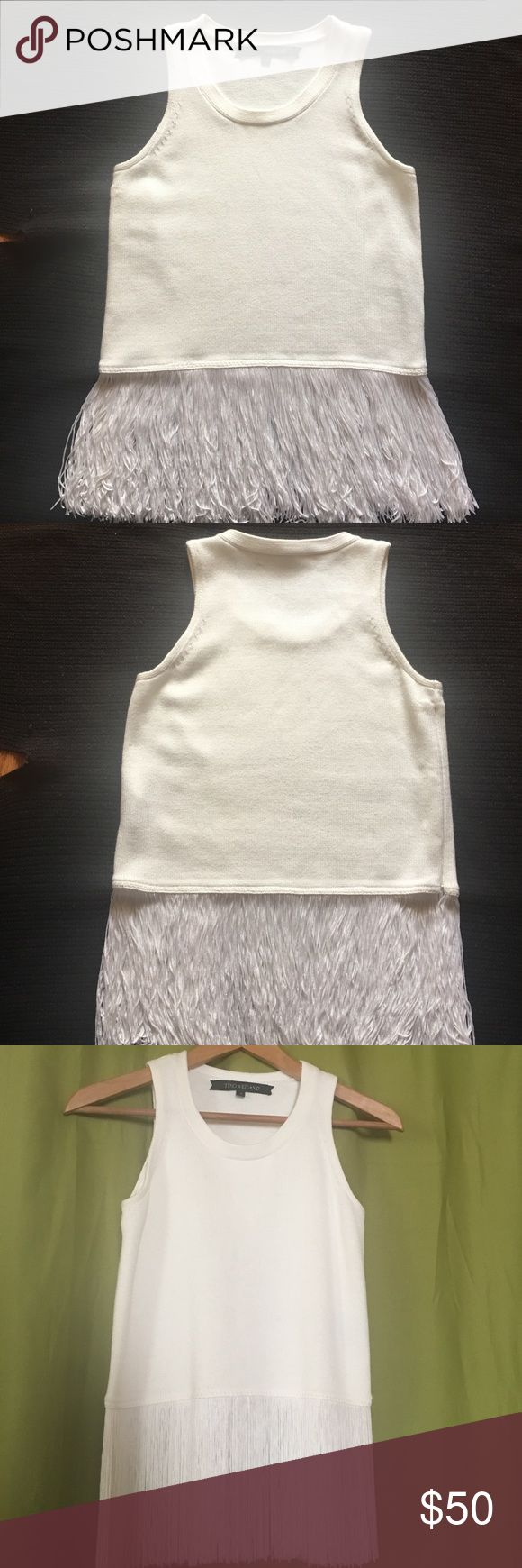 Timo Weiland White Fringe Knit Tank This fringe top is super soft and comfortable to wear, it has a side zipper for easy on-off access. Fringe is tangle, knot free, no missing pieces. Ready to wear.....stain and smell free, only tried on, never worn, but no tags. Would look great with some jeans or a pretty skirt...or a leather jacket and some leggings! Timo Weiland Tops Tank Tops