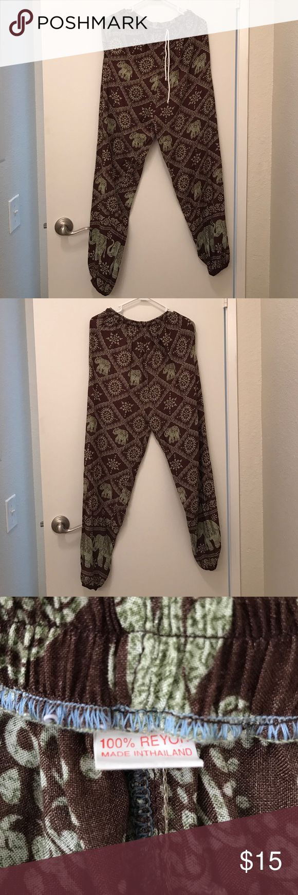 Maxi Pants Green and brown maxi pants. They're tight at the waist and bottom and baggy all throughout. Has tie up draw strings and pockets. Size small. Has elephants and cool designs all over. No Brand Pants