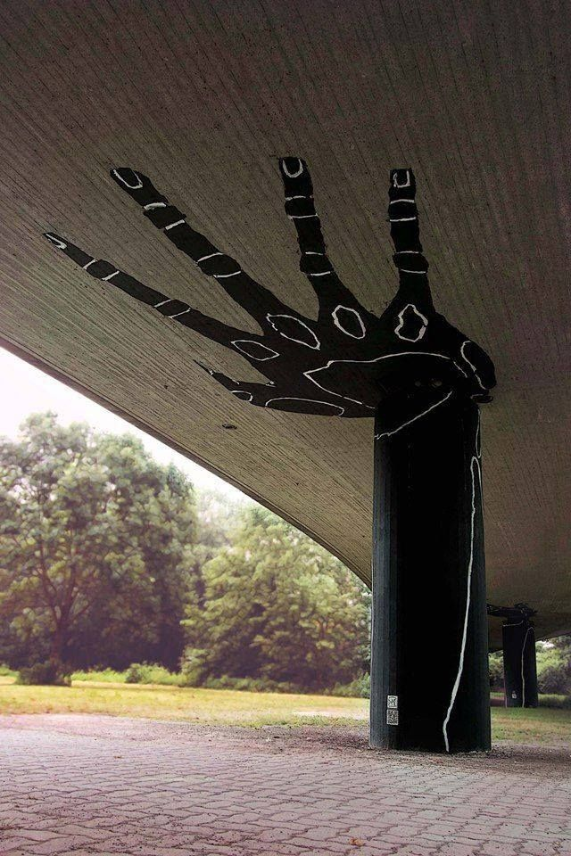 What a fantastic imagination some street art artists have!  Who would have thought to dress up an ordinary pylon by painting a spectacular aboriginal hand? I notice the column in the background is also painted the same. This is beautiful.