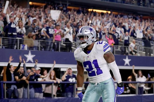 Ezekiel Elliott Photos Photos - Ezekiel Elliott #21 of the Dallas Cowboys celebrates after scoring a touchdown against the Detroit Lions in the first quarter at AT&T Stadium on December 26, 2016 in Arlington, Texas. - Detroit Lions v Dallas Cowboys