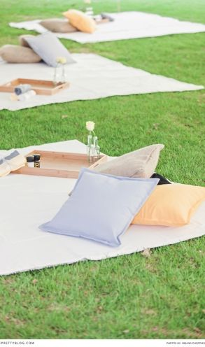 You could have an area with some blankets and pillows for guests who want to dine picnic style (if reception outside too)