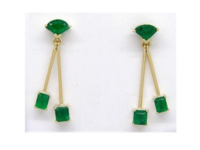 Emerald dangling earrings in 18K yellow gold with 6 natural Colombian emeralds by www.GreenInGold.com  #earrings #emeralds #gemstones #jewelry #style #fashion