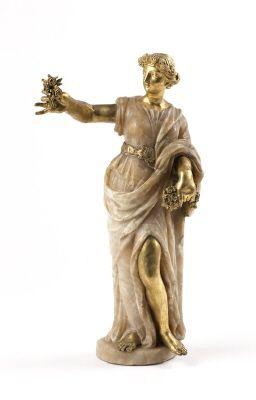 Hösten stående yngling med vinkrans om håret, huggen av alabaster, med huvud, armar, ben och attribut av gjuten brons. Från 1800 cirka.