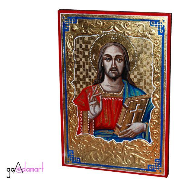 Icoana unica pictata pe lemn, cu foita de schlagmetal aurie si stucatura miniaturala manuala, reprezentandu-l pe Iisus Hristos.