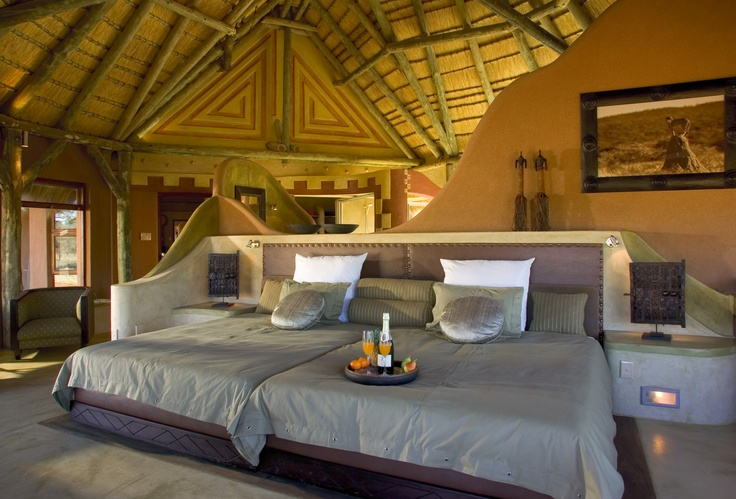 Roll down canvas partitioning enhances your 180 degree vista from your bedroom in the luxury Bush Suite, Okonjima.