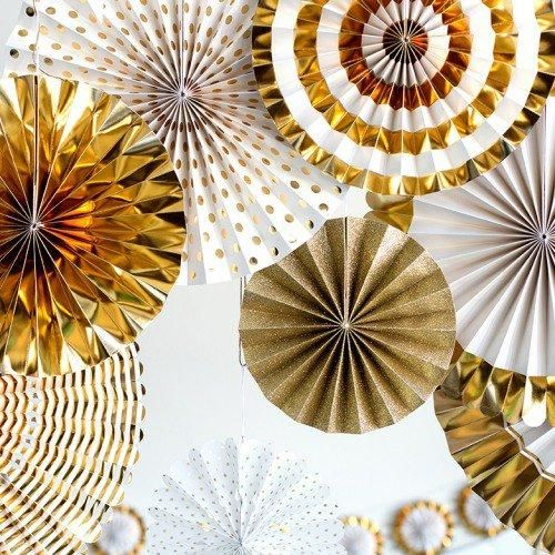 Throw the perfect golden birthday by decorating with fun paper pinwheels