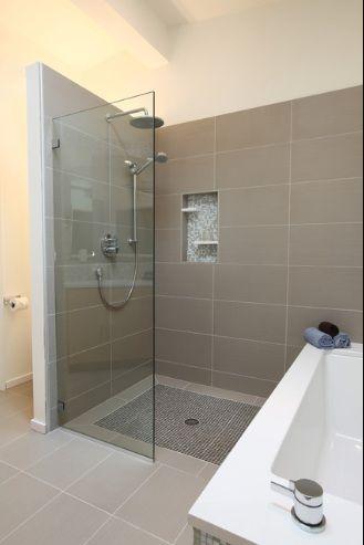 "another shield plus consider multiple shower heads  Note unique 12 x 24"" tiles"