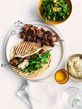 Grilled cumin and chilli lamb skewers with smoky eggplant purée.