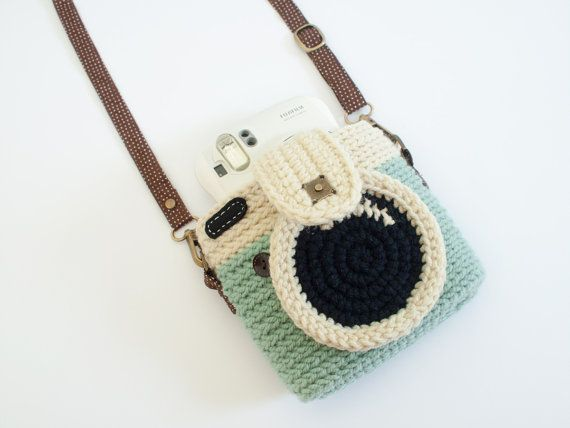 A handmade crochet purse is not a ready made product. ☆ ☆ ☆ it is MADE TO ORDER. ☆ ☆ ☆ Orders can take up to 10 days to be made and shipped.  You can put your fuji the instax mini 25,90 and 8 instant cameras. For someone who Love polariod camera. ^^  Size: 6 inches(wide) x 5 inches(hight). Material: 100% Acrylic Yarns, Felt Febric, Cotton Febric and Magnet Button. Strap bag: Brown(polka dot) fabric cross body strap.  This item will hold your: • Fuji instax mini 90 - $28 • Fuji instax mini…