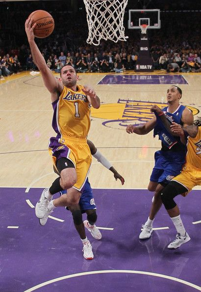 Jordan Farmar #1 of the Los Angeles Lakers drives to the basket for a layup against the Los Angeles Clippers