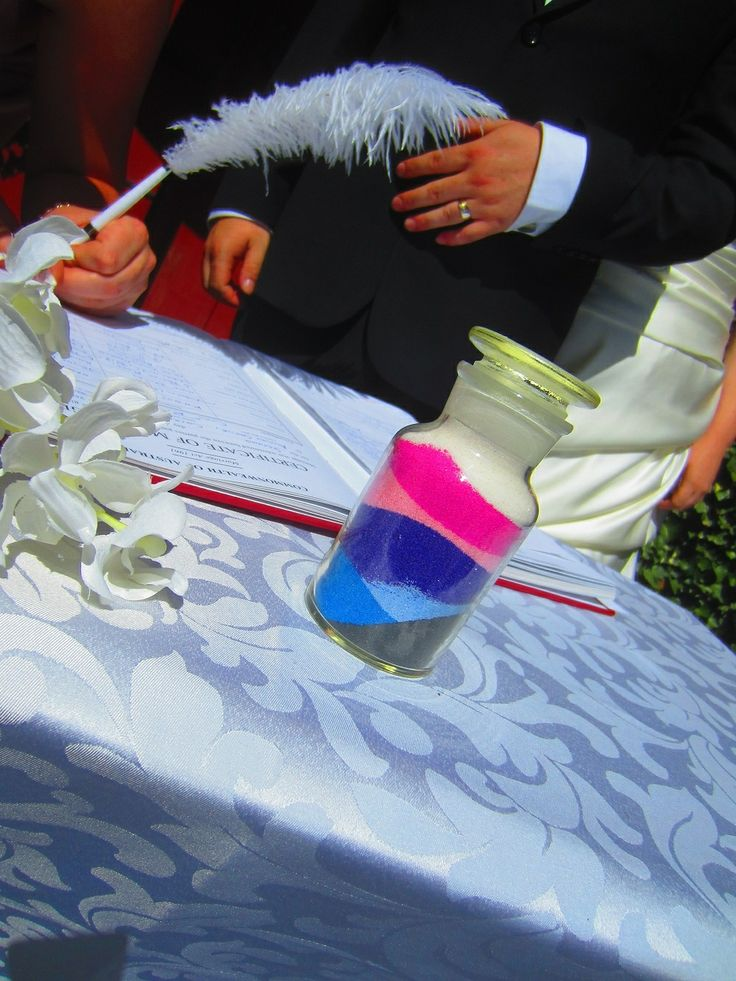 The miniature central vase of coloured sands, after being filled by young children during the ceremony