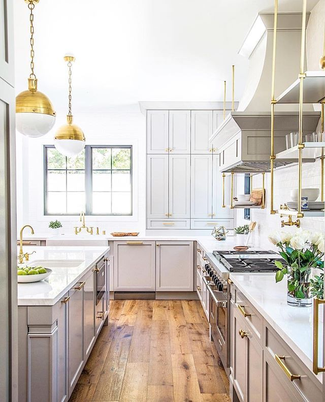 WEBSTA @ beckiowens - Brass gray beauty -- loving these open shelves!! What do you prefer open shelving or closed cabinetry?? Design @sharontaftianinteriors || builder @buildboswell