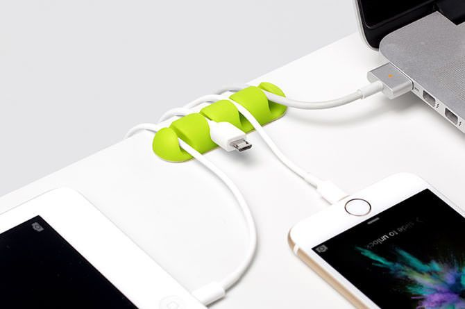 CableDrop Multi is a cable router that helps keep cables organized and prevents them from slipping away