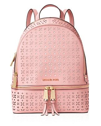 Floral-patterned perforating brings a breath of fresh air to Michael Michael Kors' supple leather backpack, the new city carryall.   Leather   Imported   Top handle, adjustable backpack straps   Zip