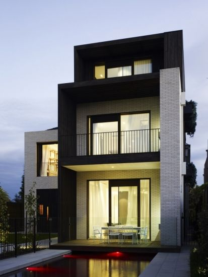 """Residential Architecture: Middle Park House by KPDO + CJA: """"..This home has had a series of renovations over the past century; the original Edwardian home was converted into apartments in the 1930s and then a substantial family home in the 1980's. Our brief was to restore the Art Deco facade, retain the existing footprint and add a third level..The house is located directly opposite the beach in Middle Park and is constantly filled with beautiful light. Morning sun strikes the garden aspect…"""