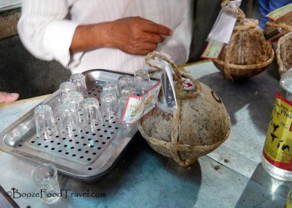 Coconut liquor during a tour of the Mekong Delta, Vietnam