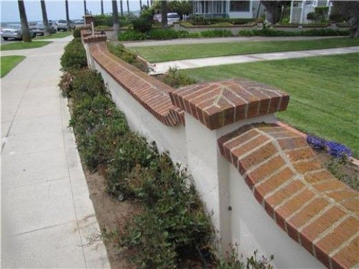 17 best images about stucco walls with brick top on for Stucco garden wall designs
