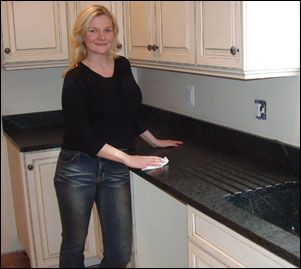 ONLY Soapstone will go in my Kitchen!!  Soapstone counter, soapstone sink with drain.
