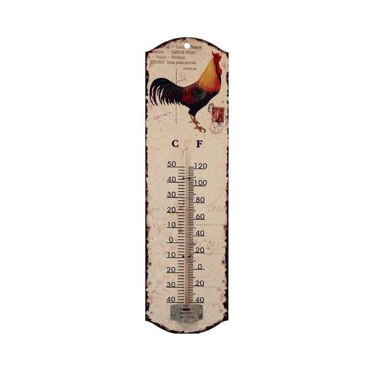 Metalowy termometr z kogutem, w kolorze kremowym z lekkimi przetarciami.