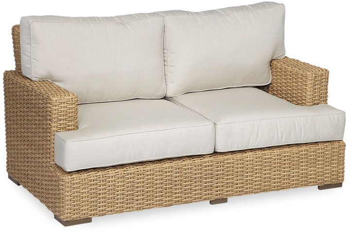 Crafted with a resin wicker frame and Sunbrella upholstery, this cushy loveseat adds tropical appeal to any outdoor space. Furniture > Outdoor Furniture > Outdoor Sofas & Love Seats.