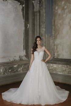Serena  Silhouette: Princess Gown Neckline: Bateau Sleeve: Sleeveless Decoration: Sequin bodice with lace appliqué throughout the skirt. Train: 80cm