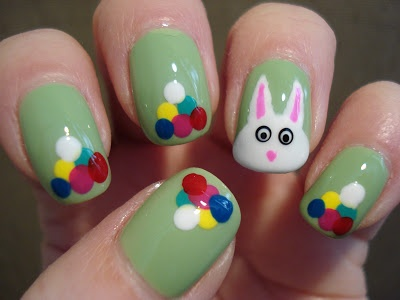 Little Miss Nailpolish: Easter Bunny and Eggs Tutorial check out www.MyNailPolishObsession.com for more nail art ideas.