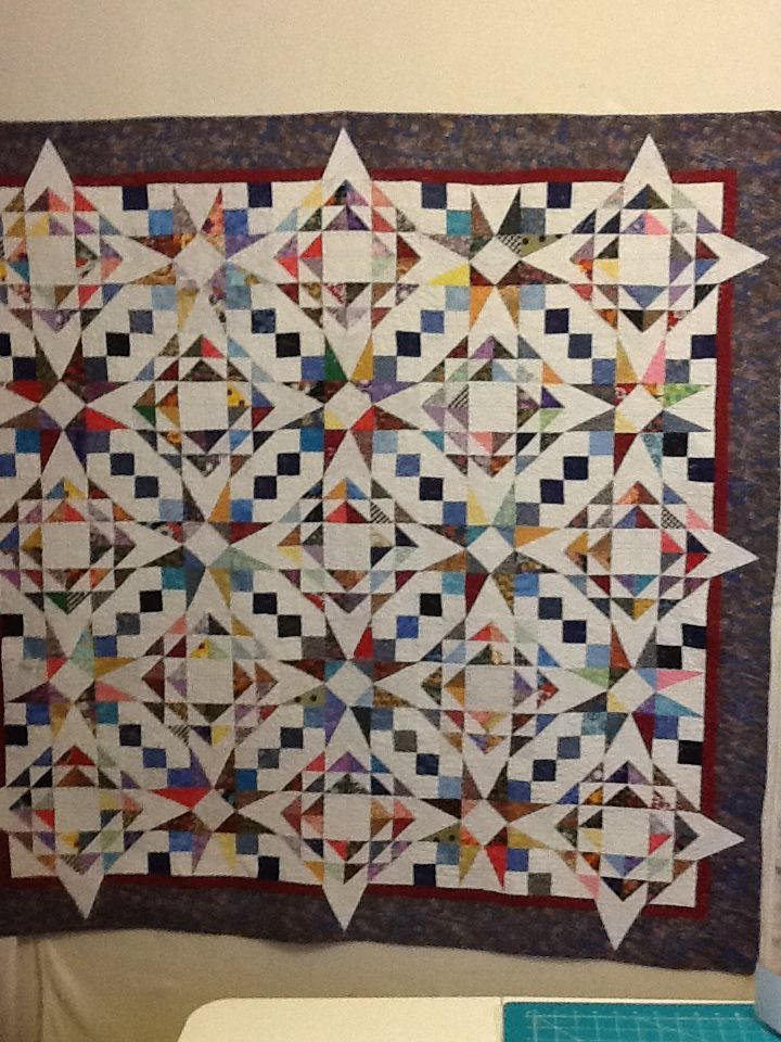 The circular design that emerges on this scrappy quilt is created by the pairing of two blocks: 54-40 or Fight and Corn and Beans.  Just love the way the points extend to the borders
