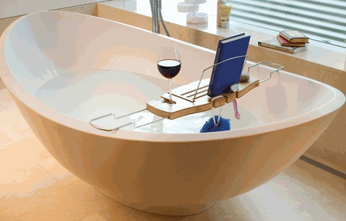 The ultimate bathtub caddy, complete with book & wine glass holder! #relax #organized