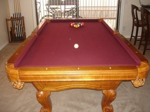 """For sale: 8' x 4' pool table in really nice condition. If I remember correctly it has a 1"""" slate. Includes full set of balls, 2 pool stick racks, 9 pool sticks, 2 table brushes, 11 blue chalk squares,..."""