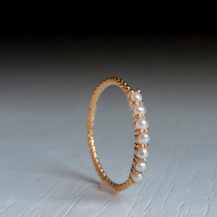Gold pearl eternity ring - pearl ring by ARDONN on Etsy https://www.etsy.com/listing/223130284/gold-pearl-eternity-ring-pearl-ring