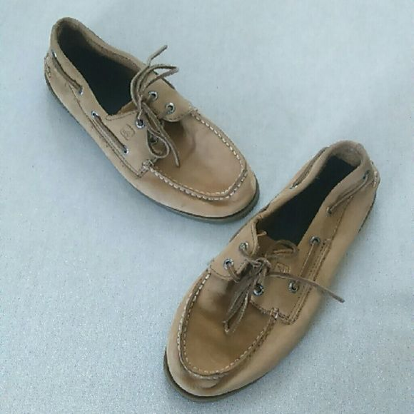 ??Sperry tan leather boat shoes?? These shoes were worn 2 times. They are a boys size 5.5, which equates to a ladies 7.5. Excellent condition. I ship quick and love??REASONABLE offers. Smoke and pet free, ?NO TRADES, NO HOLDS, POSH RULES ONLY!!? Sperry Top-Sider Shoes Flats & Loafers