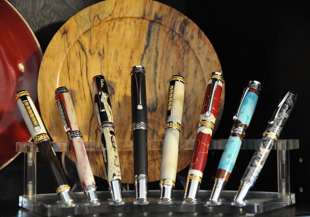 Phil Morris has been turning pens from his garage workshop crating one of a kind instruments ranging from functional to ornate. He gave a tour of his studio and collection Monday July 21, 2014 in Columbiana, Alabama.  (Frank Couch/fcouch@al.com)