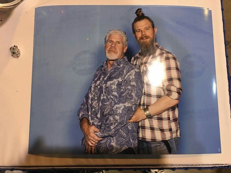 RON PEARLMAN AND RYAN HURST AT COMICCON DOING THEIR PROM PHOTO