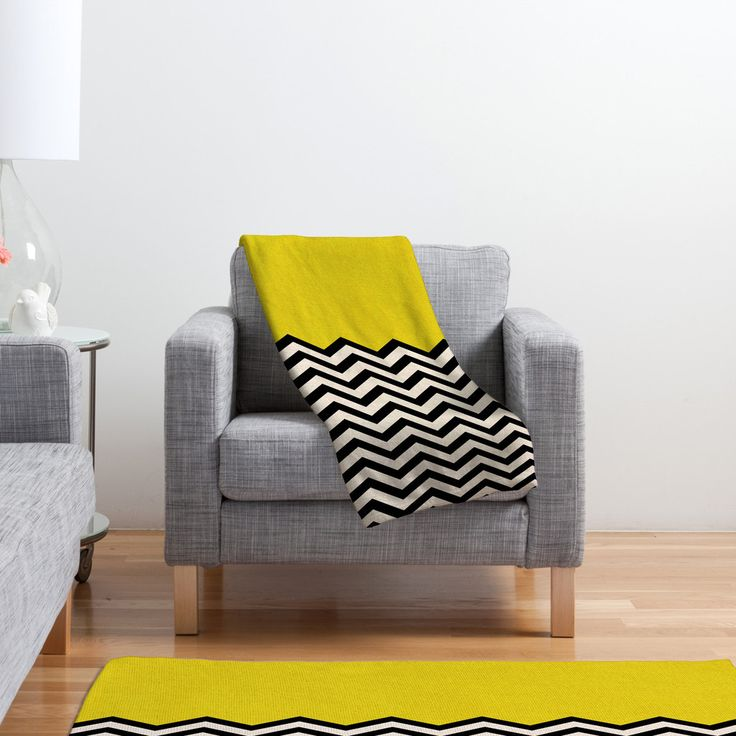 Custom made for every order, this 100% polyester fleece throw blanket dances in the flow of geometry, and is accented with a gorgeous, spunky mustard yellow. A great accent piece for minimalist décor, the Geometric Waves Fleece can be machine-washed on cold and tumbled dry for easy care.