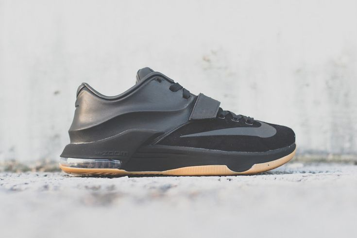 The popular Nike KD silhouette undergoes an all-black treatment in this latest rendition of Kevin Durant's namesake shoe. The upper sports a suede forefoot with prominent Swoosh branding, which cuts t...