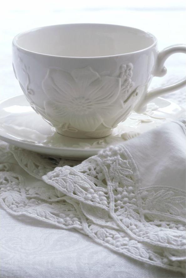 White teacup & saucer...linens.