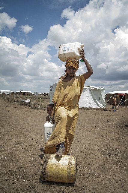 Kakuma refugee camp Northern Kenya   Woman carrying water
