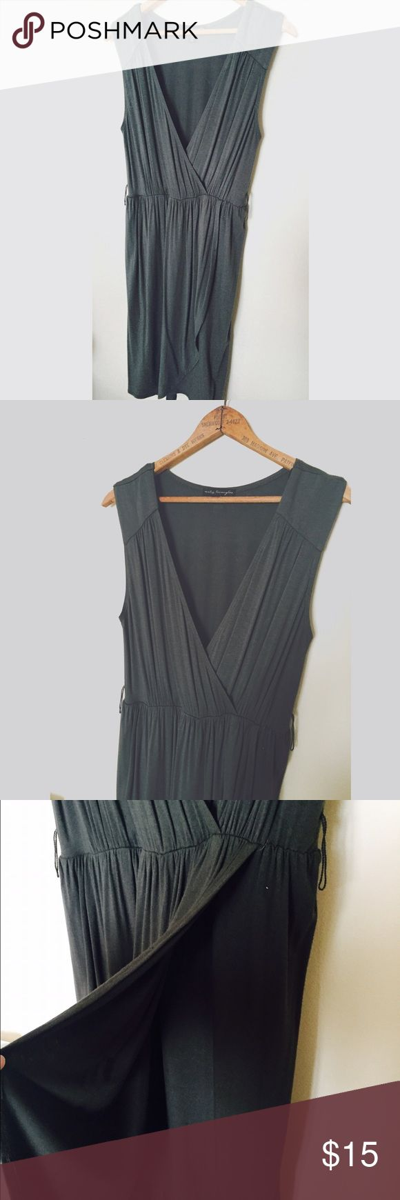 Army Green Dress So comfortable and flattering with a v-neck top and a wrap like skirt. It has an elastic under the bust. Does not come with the belt. City Triangles Dresses Mini
