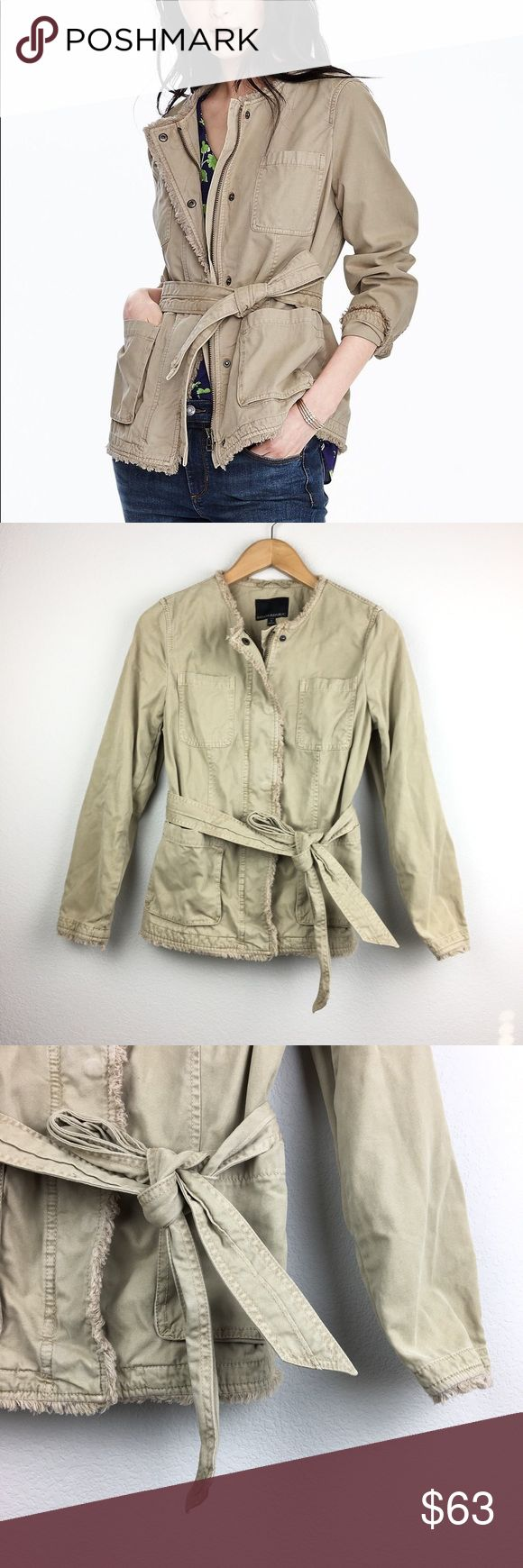 Banana Republic Tan Frayed Edge Military Jacket 100% cotton. Mid-weight fabric. Tan/khaki color. Zippered front with snap closure. Frayed edge detailing. Tie at waist. Open chest and front pockets. Excellent pre-owned condition. Banana Republic Jackets & Coats Utility Jackets