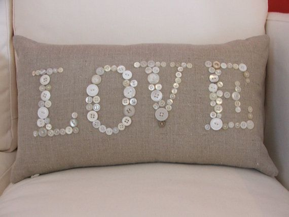 Sooo cute! I'm thinking maybe make the pillow itself too...pick out the perfect soft fabric and coordinating buttons...and maybe lowercase with initials added