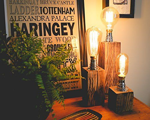 A Trio of Chunky Jacobean Dark Oak Table Lamps with Vintage Bulb and Copper Look Cage