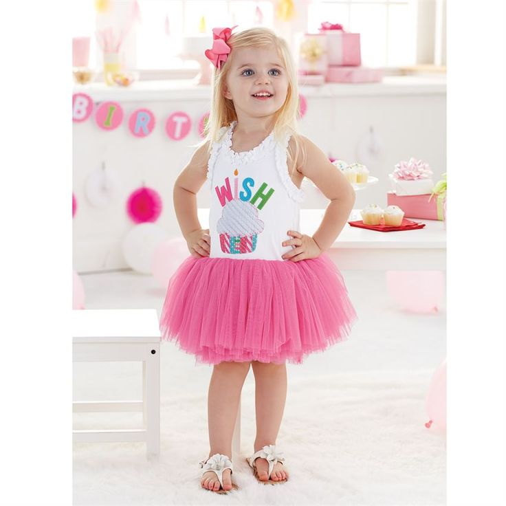 Cotton interlock tank dress with attached tiered mesh skirt features ruffle neckline, grosgrain bow back and felt 'WISH' appliques with ribbed chenille and printed poplin cupcake accent. Makes the perfect outfit for any party! #MudPieGift