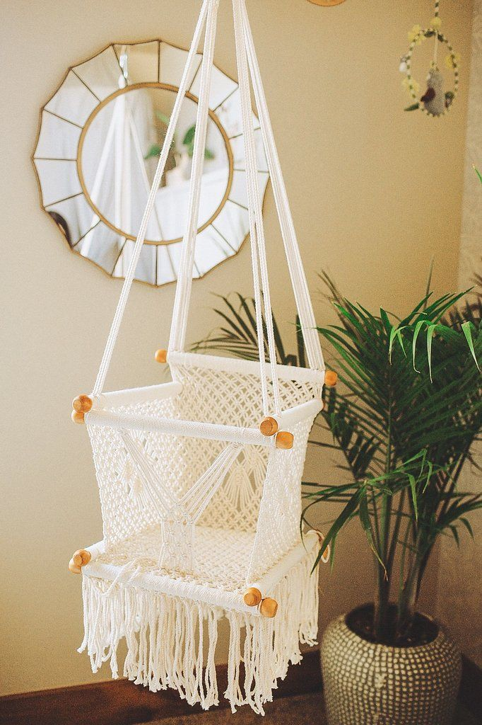 Macrame baby swing handmade in Nicaragua. Cream coloured macrame baby hammock with wood detail. Available at adelisaandco.com