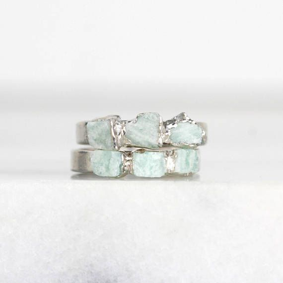 AMAZONITE STACKING RING - RHODIUM PLATED These best-selling gemstone rings are a crowd favorite. Raw stones are hand selected, sculpted, and set in a 3mm band for a one-of-a-kind ring. Designed to be mixed and matched however you please. ♦ THE LITTLE DETAILS • One amazonite ring •