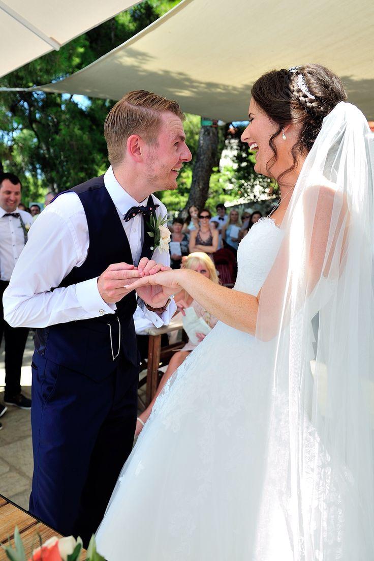 Exchanging rings. Skiathos, Greece wedding