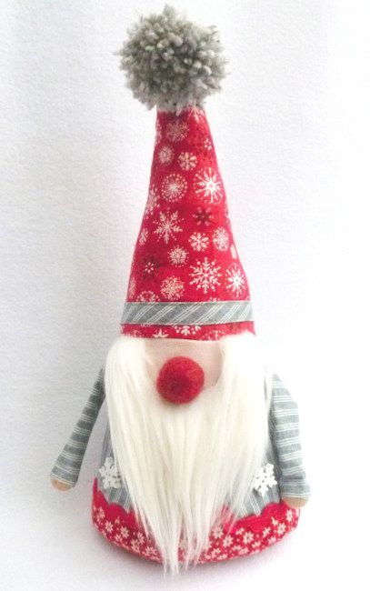 FREE PATTERN DOWNLOAD: Make this God Jul Nisse Santa Gnome Doorstop using the Scandi 4 collection by Makower. Designed by Debbie von Grabler-Crozier