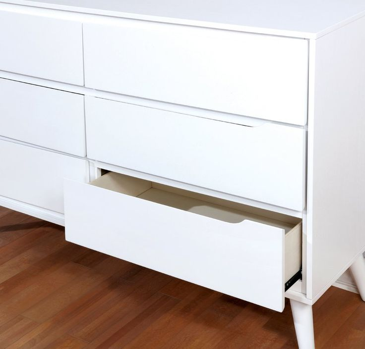 An innovative design with a refined appearance, this dresser is a chic mid-century modern fixture sure to simplify your bedroom storage situation. Between the six drawers with cut-out drawer pulls and the spacious tabletop, this piece offers ample room for your clothes and other items. This dresser is supported atop sophisticated angled and tapered legs.